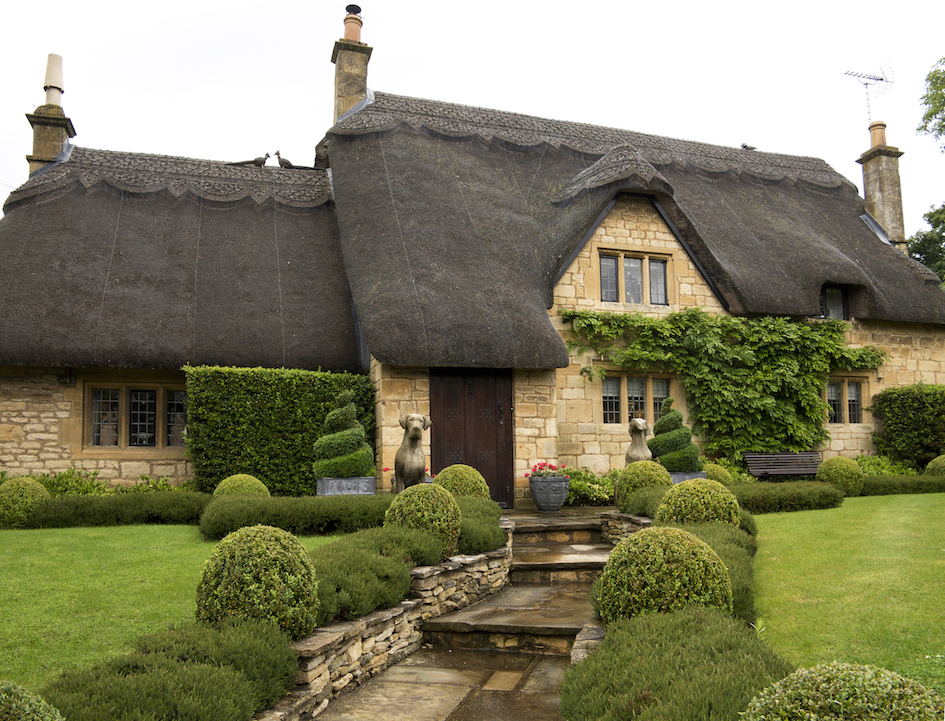 cotswold cottage with shaped hedges in beautiful front garden